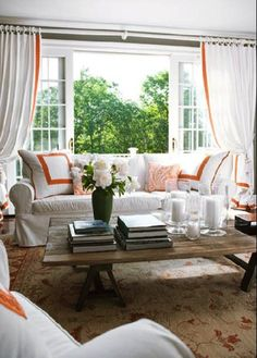 Yes please!  Love the pillows on the couch and those beautiful drapes.