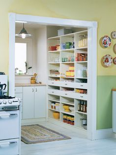 A retro kitchen featuring a walk-in pantry with cabinets, drawers and a (great idea) WINDOW.