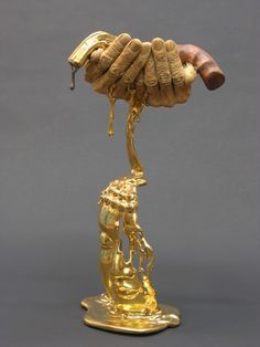 Ceramic Hands Holding a Melting Revolver Symbolizes Hate Converted to Peace - My Modern Met