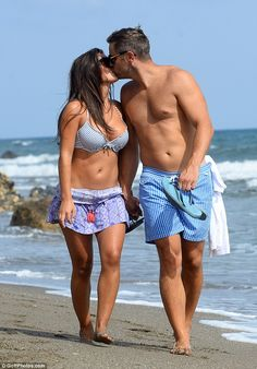 Sealed with a kiss: Elliott Wright and his fiancée Sadie Stuart are still living the high life in Marbella, enjoying a fun-filled beach outing earlier this week as they spent some quality time together