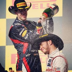 """""""Sebastian Vettel (COTA 2013) and Lewis Hamilton (Indianapolis 2007 and COTA 2012, 2014), are the only current drivers to have won the US GP. __________  Pic: Seb pouring champagne on Lewis, on the 2012 US GP podium."""