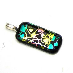 Check out this item in my Etsy shop https://www.etsy.com/uk/listing/258603845/heart-design-dichroic-pendant