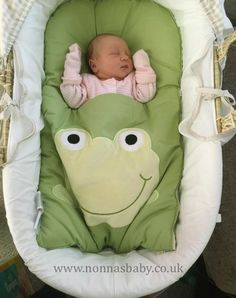 """Three days old Phoebe is adorable, with her big smiling frog watching over her. Mummy Cara told us """"this is our little one Phoebe at 3 days old enjoying her froggy nap mat!! She absolutely loves it!!"""" Nonna is delighted! :-) • More about Nap Mats: https://nonnasbaby.co.uk/baby-nap-mats/"""