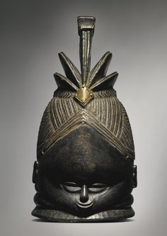 Sotheby's PROPERTY FROM THE COLLECTION OF THE LATE DR MONNI ADAMS Mende Helmet Mask, Liberia