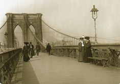 Well-dressed men and women circa 1890, suspended between the city of New York and the city of Brooklyn. Judging by all the smoke in the background, it looks like the camera is facing the Brooklyn side.    At the time this photo was taken, the bridge was only seven years old.