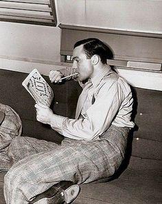 Gene Kelly doing a crossword...