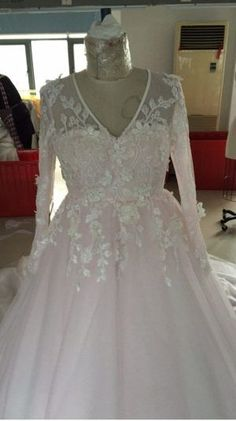 Here is a blush colored plus size wedding gown with long sleeves.  The v-neck is flattering.  The ball gown style will hide the hips.  We make custom #weddingdresses and #replicas of couture designer #dresses too.  So if your dream dress is out of your price range we can help.  We can make an inspired version that will have the same look & feel but cost way less than the original.