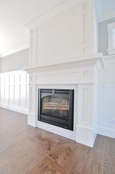 Craftsman fireplace mantel with board and batten wainscoting. Craftsman fireplace mantel with board Craftsman Fireplace Mantels, Home Fireplace, Fireplace Remodel, Living Room With Fireplace, Fireplace Surrounds, Fireplace Design, Home Living Room, Fireplace Ideas, Fireplaces