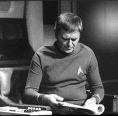 @star_trek_tos su Instagram: Behind scene. James Doohan on command chair during the script checking...