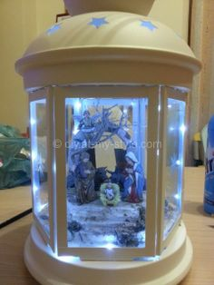 Christmas nativity in a Rotera lantern