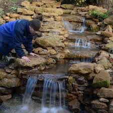 Image result for constructing backyard waterfalls