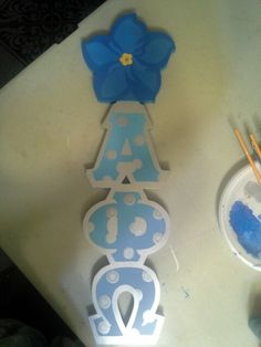 2ft Alpha Phi Omega Fraternity paddle with forget me not handle. Designed by Greek Wood Custom Designs.