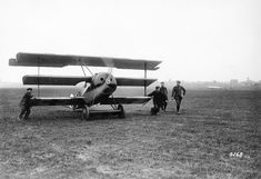 Ground crewmen help guide a Jasta 27 Fokker Dr.I into position for takeoff at Halluin-Ost near Flanders in May 1918.