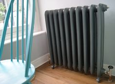 Castrads Duchess 790mm cast iron radiator finished in Pewter. Installed in North London.