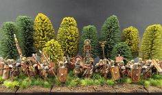 28mm Victrix Limited Early Imperial Roman EIR - Britannia Patrol Meanwhile somewhere in Britannia. An Early Imperial Roman Patrol prepares to embrace the Locals with Rome's Warm Loving Embrace. Vallejo/Scale 75 ~ BZB (Buffer Zone Basing) ~ Leadbear's Tufts (Of course)