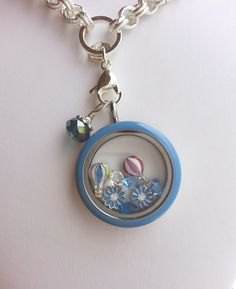Origami Owl Blue enamel face locket. Click on the pic to order. A little sunshine on a cloudy day.