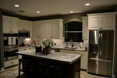 1915 Spreading Bough Ln Richmond, TX 77406: Photo Kitchen at night with recessed cabinet lighting.