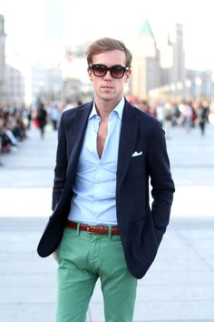 Navy blazer, pale blue shirt, brown leather belt, bright green chinos.