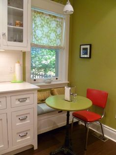 small window seat in kitchen - clever idea for small space - put storage underneath