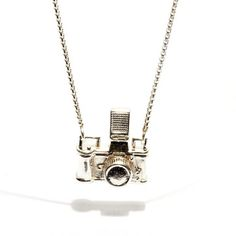 Designer camera #necklace, a little bit more expensive than the camera necklaces I pinned before.