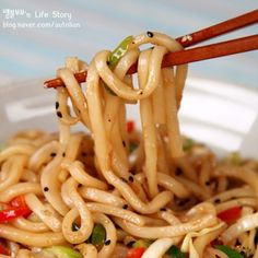 Vegetarian Stir-fried Udon  (Sauce) soy sauce 3tbsp, sugar 1tbsp, seseme oil 1tbsp, chopped garlic 1tsp  1. Stir fry vegetables of choice on high heat and set aside (i.e.: onions, bell peppers, scallions, bean sprouts, etc)  2. Stir fry udon noodle with sauce  3. Add vegetables to the noodle and finish with black pepper and seseme seed