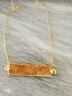 A personal favorite from my Etsy shop https://www.etsy.com/listing/198301091/gold-druzy-bar-necklace