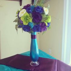 Peacock wedding centerpiece by KreativeCreations11 on Etsy, $29.99  I need this bouquet but with real flowers! It even matches the bouteniers.