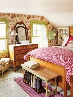 Red and Green Room    Heirloom floral wallpaper is a lovely compliment to a blossoming rosebud bedspread in this eclectic bedroom. Calming green paint on the window frames and bench balances bold red linens.      Read more: Bedroom Design Ideas - Guide to Bedroom Design - Country Living