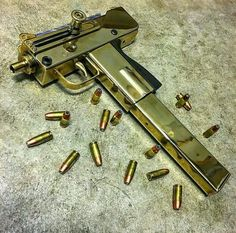 Gold Mac 10. Loading that magazine is a pain! Get your Magazine speedloader today! http://www.amazon.com/shops/raeind