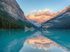 As is the case with most glacial lakes, Lake Louise is surrounded by rugged mountains and filled with clear, vibrant water.