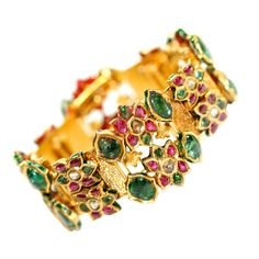 Indian Bracelet emerald ruby diamond gold | From a unique collection of vintage charm bracelets at http://www.1stdibs.com/jewelry/bracelets/charm-bracelets/