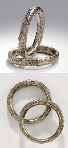 Oman | Pair of bracelets ~ Awathid ~ hollow, containing small stones; silver alloy. | ca. 20th century // ©British Museum. 70.2012.20.5.1-2