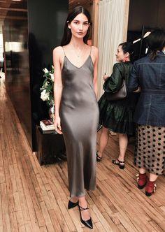 Lily Aldridge in a silk Michael Kors slip dress and black pointed-toe heels