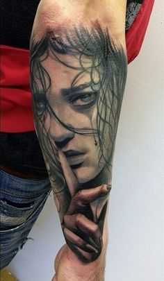 Awesome crying girl face tattoo on outer forearm