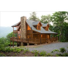 This reminds me of the cabin my husband and I stayed in on our Honey moon in North Carolina. I would love one day to live out my old age in a place like this with my husband :)