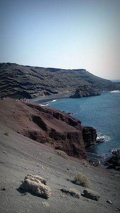 Rode and got bit by some camels here (Lin was laughin' out loud..) and did some wind-surfing. Lanzarote, Canary Islands.