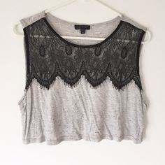 """topshop lace crop top. the cutest and softest slub and lace accented crop top from Topshop.  16"""" long from shoulder, approximately 19"""" wide laid flat at bust.  worn a few times, like new, lace is stunning!  body 63% viscose, 29% cotton and 8% polyester.  Trim is 100% nylon.  size 6 u.s.  loved wearing this with a high waisted skirt. Topshop Tops Crop Tops"""