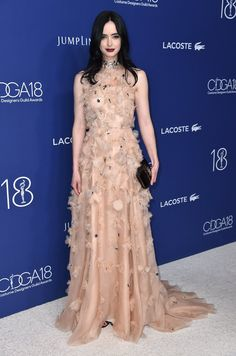 Actress Krysten Ritter contrasted the sweet feathers in her Lela Rose gown with a dark, gothic lips, at the Costume Designers Guild Awards in Los Angeles.