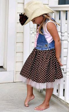 Cut off denim overalls. Attach gathered skirt with tulle under-ruffle.