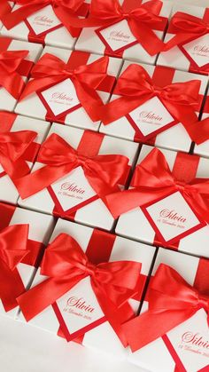 Unique birthday party favor box with red satin ribbon bow and custom name. Chic Sweet 16th party bonbonniere. Elegant personalized gift boxes make a unique way to thank guests for attending your special day. #welcomebox #giftbox #personalizedgifts #bonbonniere #sweetlove #favorboxes #candybox #elegantparty #partyfavor #giftboxes #uniquegift #gatsbyparty #birthdaypartyideas #birthdaypartythemes #birthdaypartyfavors #sweet16