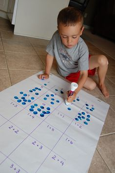 LOVE this idea! Use two different colored bingo dabbers to show an addition problem!  This would also be great for multiplication!