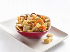 Cheesy Ranch Chex Mix - Ranch dressing and Parmesan cheese mingle together to flavor this popular and tasty snack. Quick Snacks, Yummy Snacks, Yummy Food, Savory Snacks, Filling Snacks, Healthy Snacks, Simple Snacks, Creative Snacks, Yummy Eats