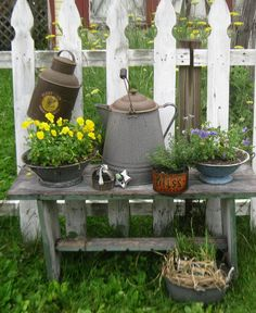 Junk & Natural Garden - barn wood bench with galvanized gardening accents