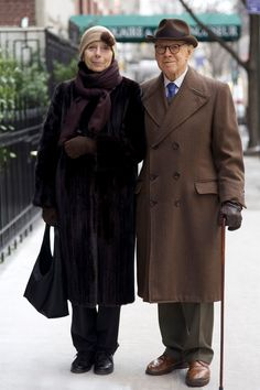"""When I complimented this gorgeous couple on how wonderful they looked the gentleman responded, """"We are trying to lift New York out of the dark."""" They posed for a quick photo and were swiftly on their way. Der Gentleman, Gents Fashion, Stylish Couple, Mature Fashion, Advanced Style, Glamour, Ageless Beauty, Fashion Couple, Lady And Gentlemen"""