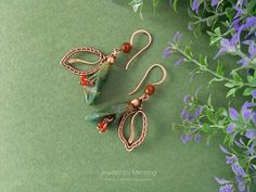 Wire wrapped floral earrings are made of copper with Indian agate and beads of red and dark orange agate in boho jewelry style. These flower earrings can be a nice gift for a woman who loves green and red colors and unusual wire wrapped copper jewelry. Size with the hook is about