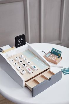 We love this wooden cash register in light colours by Kids Concept. Perfect for a little kiosk or imaginary store. The cash register has buttons to Kids Play Store, Cash Register, All Toys, Outdoor Toys, Montessori Toys, Creative Play, Wood Toys, Toddler Toys, Toys For Girls