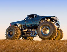 A monster truck is a vehicle that is typically styled after pickup trucks' bodies, modified or purposely built with extremely large wheels and suspension. They are used for competition and popular sports entertainment and in some cases they are featured alongside motocross races, mud bogging, tractor pulls and car-eating robots
