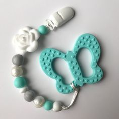Items similar to Silicone pacifier clip, Girl's Flower accent soother / dummy clip & optional butterfly teether - chew bead paci clip - fancy pearl, marble on Etsy Teething Beads, Teething Necklace, Baby Bling, Newborn Toys, Dummy Clips, Baby Jewelry, Pacifier Holder, Baby Teethers, Cool Baby Stuff