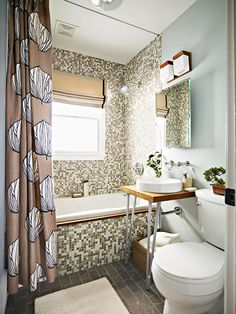 Mosaic glass tile is the focal point in this bathroom! Get more ideas here: http://www.bhg.com/bathroom/remodeling/makeover/before-and-after-bathrooms/?socsrc=bhgpin081714masculineandmature&page=21