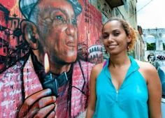 In achievement & spirit: Panmela Castro: Graffiti artist, Castro painted murals in Rio de Janeiro's favelas to inform women about new laws protecting the rights of domestic violence victims. Co-founded Artefeito, an organization that uses art as a medium to promote socially conscious campaigns.
